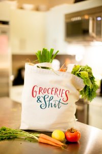 "Grocery tote bag that reads ""Groceries & Shit"""