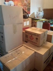 Mountains of boxes in our dining room